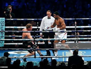 Povetkin goes down on the canvas as Anthony Joshua lands a killer blow. (photos)