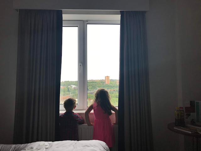 kids looking out hotel window in newcastle