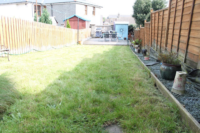 long garden with grass and decking