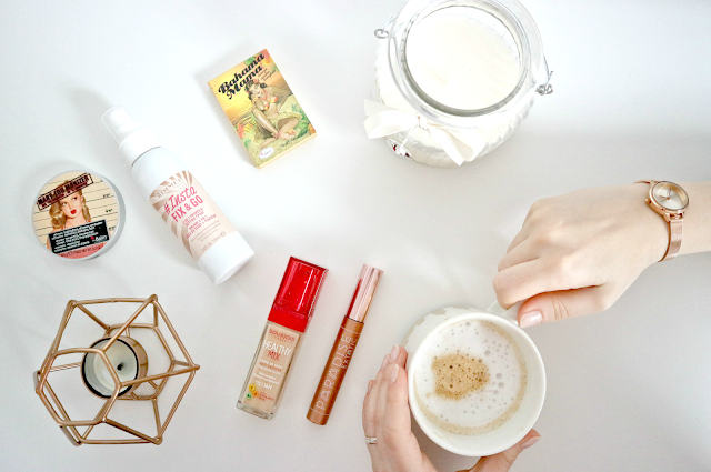beauty products and coffee mug flatlay
