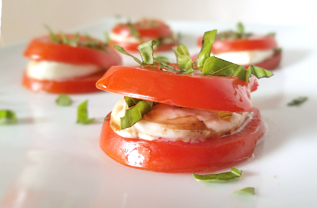 This Stacked Caprese Salad combines all the flavors of classic caprese salad, but stacking it makes it easy to serve and eat! Perfect as an appetizer at your next party or even as a side dish or light lunch, this Stacked Caprese Salad is gluten-free, grain-free, low-carb and keto-friendly.