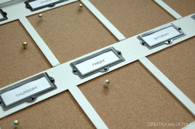 DIY cork board organizer using metal label holdeers