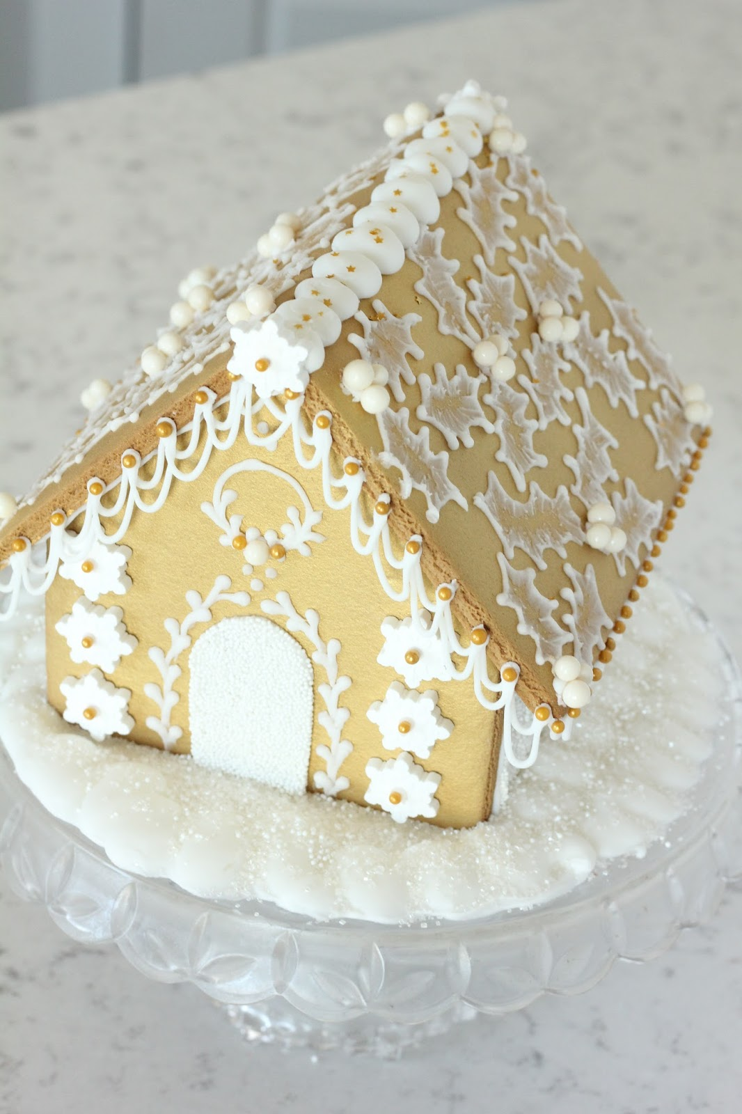 White and Gold Gingerbread House on butterfly roof designs, church roof designs, gingerbread house chimneys, gingerbread house masonry, garden roof designs, birdhouse roof designs, snow roof designs, gingerbread house details, gingerbread house roofing,