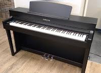 Yamaha CLP645 piano