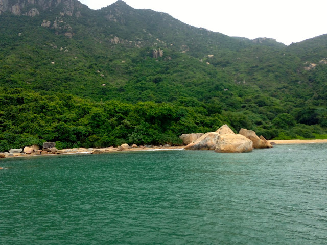 Secluded beach on Lamma Island, Hong Kong, as seen from junk boat