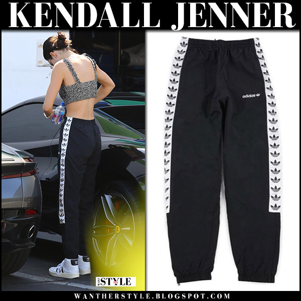 Kendall Jenner in black Adidas trefoil wind pants and white leather pants celebrities in adidas august 18 2017