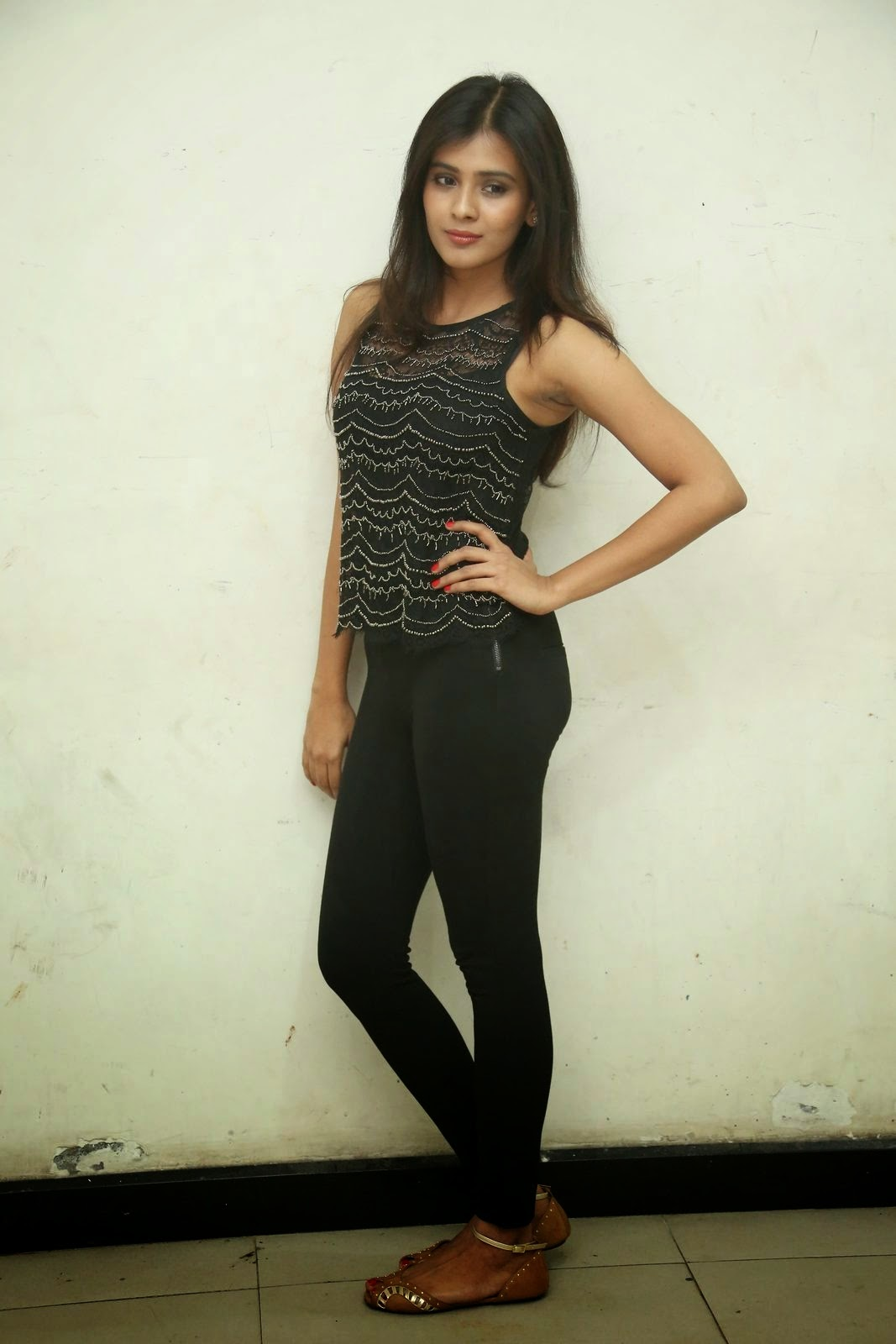 Actress Heeba Patel Stills In Black Top Jeans