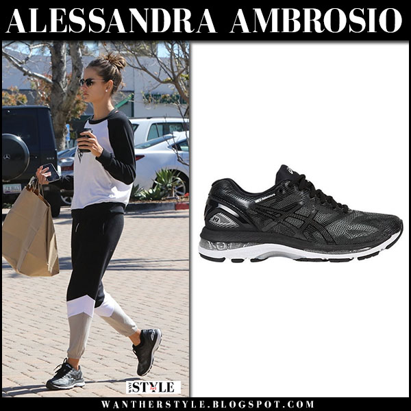 Alessandra Ambrosio in black and white sweatshirt and black sneakers asics  gel nimbus casual street fashion