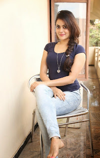 Shruthi Sodhi in Spicy Tight Purple T Shirt and Denim Pants