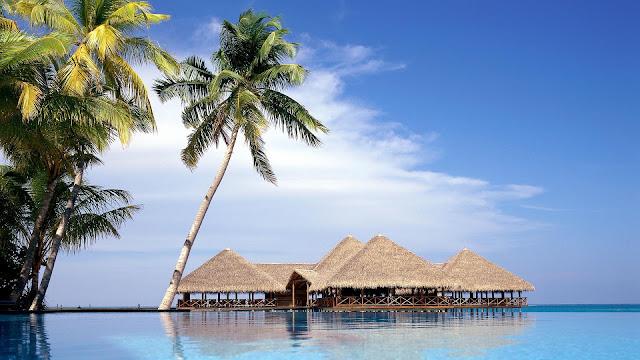 Landschap met vakantiehuisjes op het water