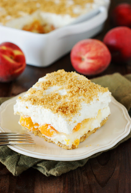 dinner No-Bake Peach Yum Yum Image ~ A classic layered no-bake dessert with a graham cracker crust and peach pie filling sandwiched between two creamy layers. It's sure to be a hit! www.thekitchenismyplayground.com