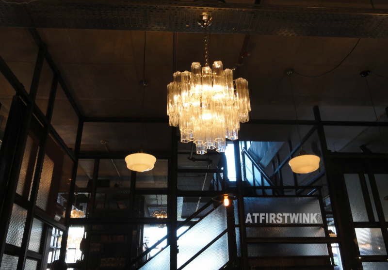 Jamie's Italian Markthal chandelier stairs lamps