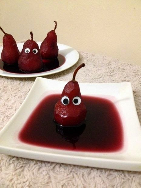 Ghostly Poached pears in Red wine Sauce