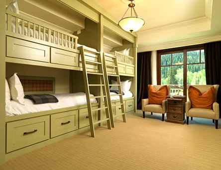 Double wooden bunk beds in the luxurious bedroom