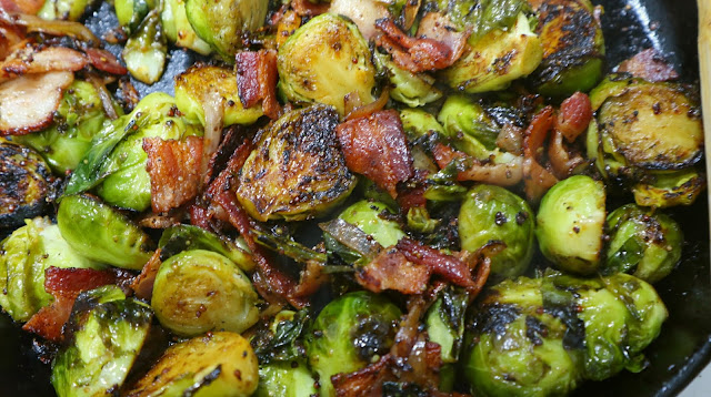 brussels sprouts and bacon all cooking in a pan