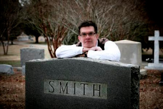 photo of author Thomas Smith standing in a graveyard