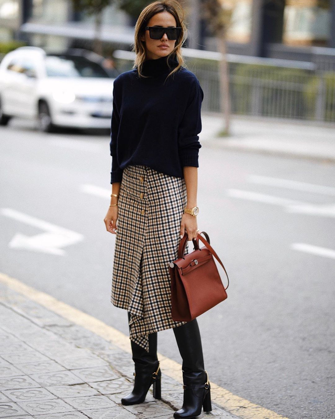 A Stylish Work-Ready Way to Wear a Plaid Midi Skirt — @ariviere in a Turtleneck Sweater, Hermes Bag, and Knee-High Boots