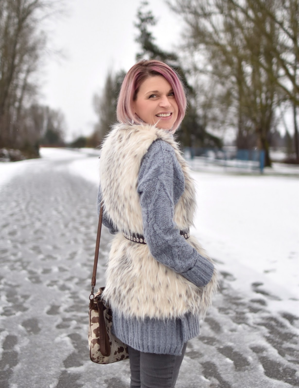 Monika Faulkner outfit inspiration - tunic sweater, belted faux-fur vest, pony-hair bag