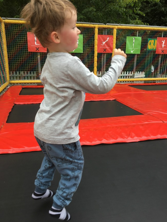boy-jumping-on-trampoline