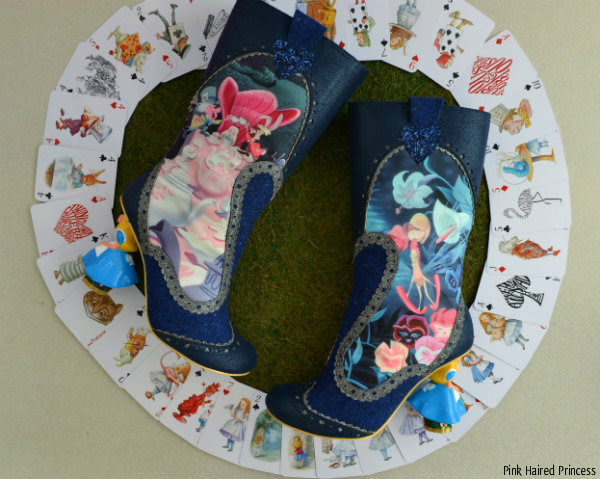 Irregular Choice Alice Lost Your Muchness boots surrounded by Disney Alice playing cards on grass