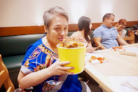 Emma Villarente with a bucket of Brian's Ribs
