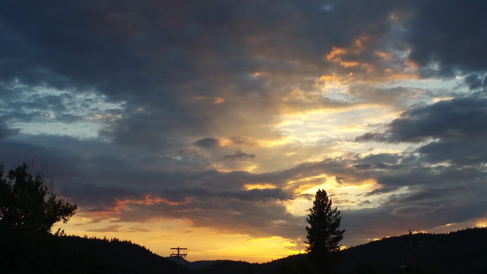 A deep orange sunset seen from a little town.