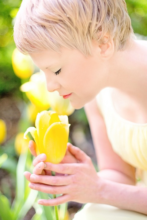 beautiful blonde with great skin inhaling scent of a tulip.jpeg