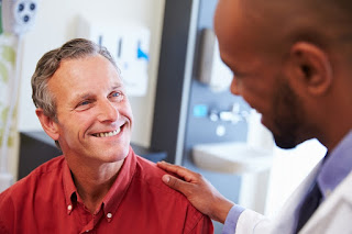 A doctor and patient talking and smiling
