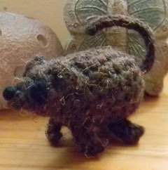 http://www.ravelry.com/patterns/library/tiny-pets--pet-house-toy-bag