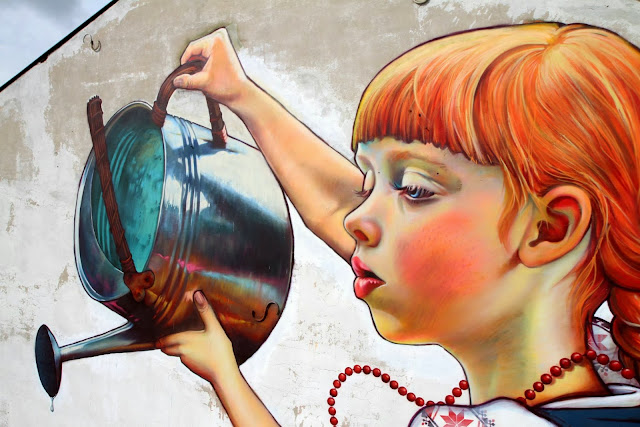 Polish Street Artist Natalia Rak Paints A New Mural On The Streets Of Bialystok For Folk On The Street. 6
