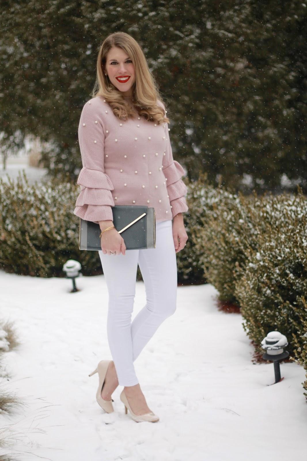 pink ruffle sleeve pearl embellished sweater, white jeans, nude heels, grey envelope clutch
