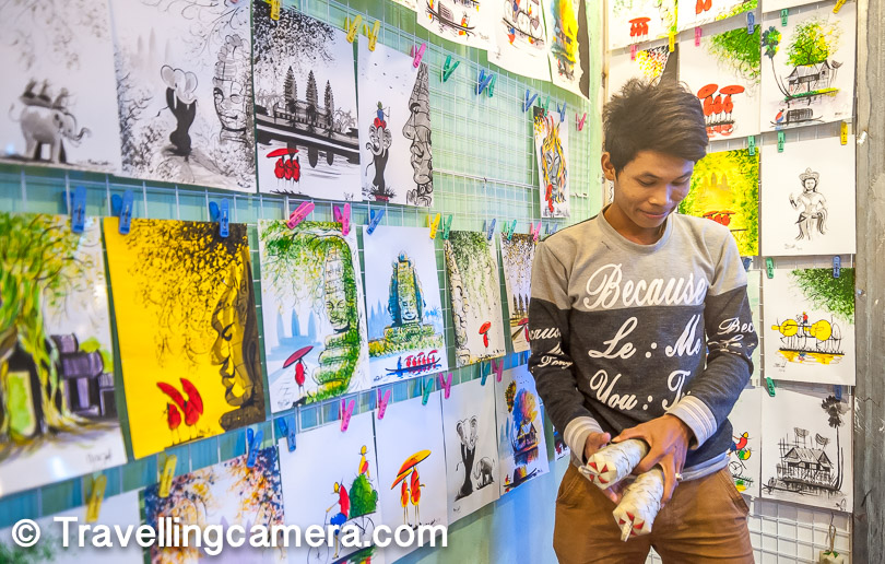The night market was also a great place to see some local art. All of the paintings in the background were made by this guy standing here. In fact, when we arrived at his shop, he was in the process of creating one such painting. We were awestruck by his talent.