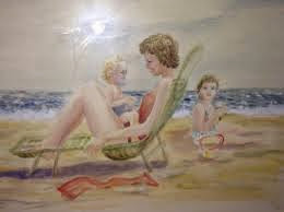 Mother and children on a beach