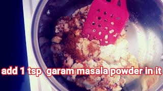 image of adding garam masala in stuffing
