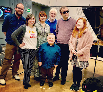 Photo of seven people including Simon, Kate Monaghan, Purple Space Kate Nash, make up and cover girl Lucy Edwards, pianist Derek Paravacini, author Christian Donlan