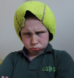 cut open tennis ball on head as hat
