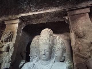 Stone figures in Elephanta Caves