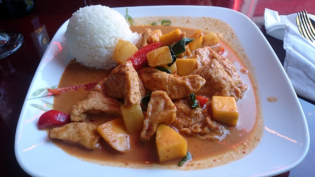 A plate of delicious-looking red Thai curry.