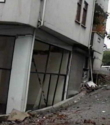 Earthquake foundation failure resulting tilted building