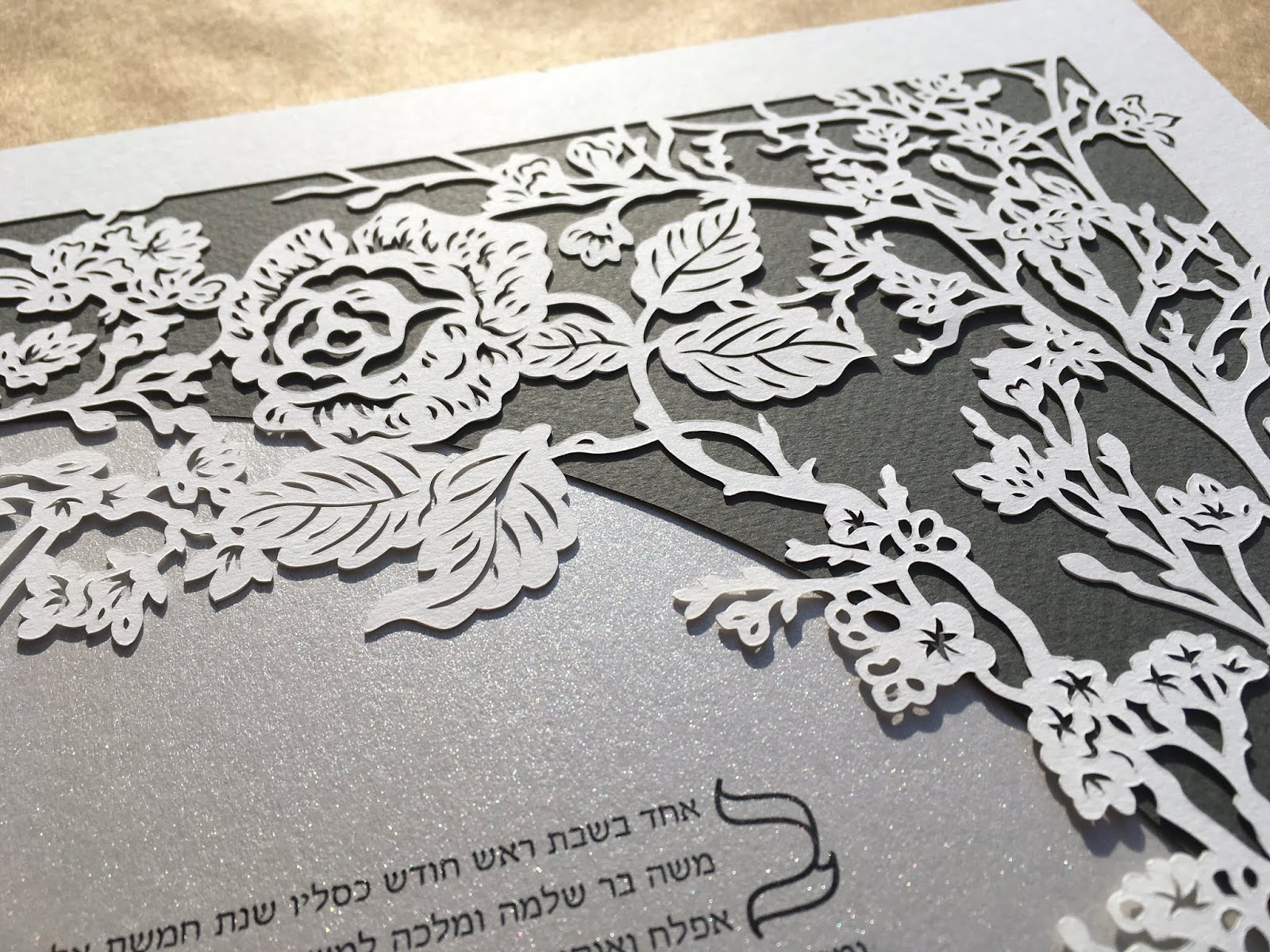 Handmade papercut by Naomi Shiek features delicate flowers and blooms such as Cherry Blossom branches, Roses, and Daisies