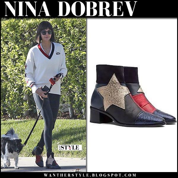 Nina Dobrev in black star embellished ankle boots tommy hilfiger walking her dog casual fashion december 1