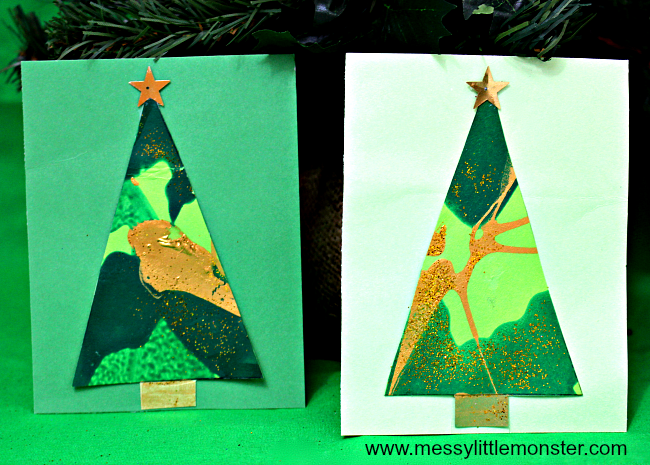Toddler or preschooler made DIY Christmas tree greeting card .An easy Christmas card craft ideas for kids using a fun spin art painting technique.