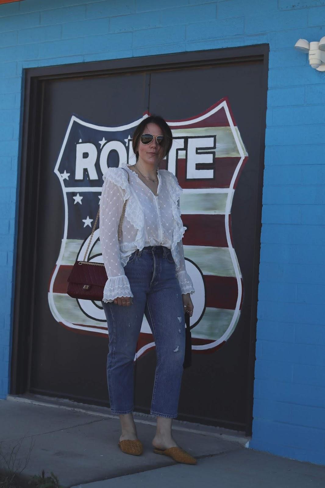 kingman arizona white ruffle blouse outfit levis wedgie jeans spring travel outfit aleesha harris