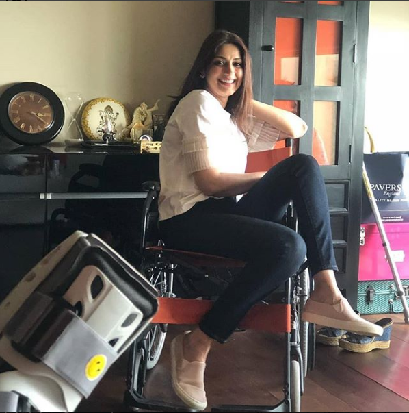 Sonali Bendre  on a wheelchair