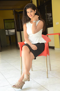 Pavani Reddy in Short Black Skirt and Sleeveless White Top