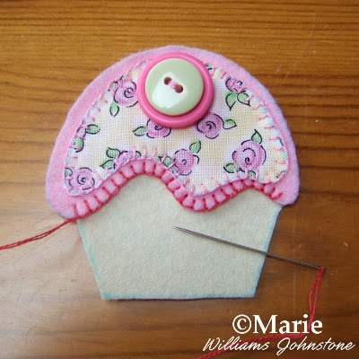 Blanket stitch sewn in a raspberry pink embroidery floss