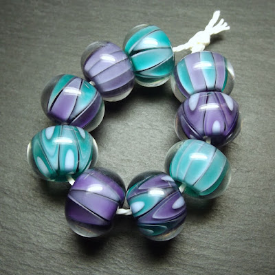 Encased lampwork glass beads by Laura Sparling