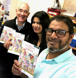 Neil Bishop, Zahira Naz and Mothiur Rahman holding up copies of the pamphlet.