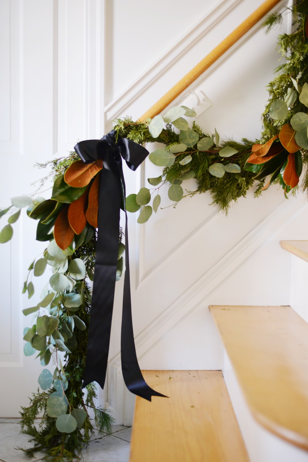 how to hang garland, wreaths, and holiday decorations using handy gadgets