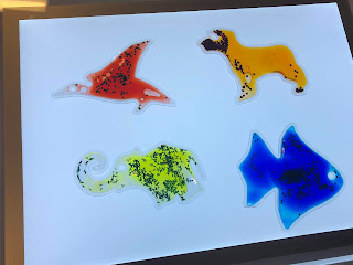 Light panel with colorful shapes of a bird, dog, elephant, and fish